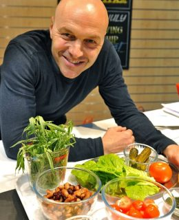 One of the celebrity chefs, Simon Rimmer, strikes a pose in the kitchen