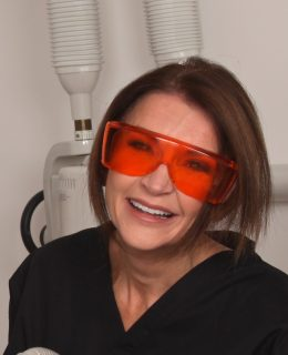 Dr Tracey Bell, pictured at work, warns of the dangers of dermal fillers