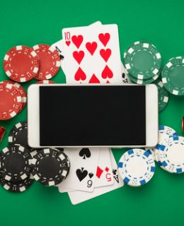 Risking it All: A 'phone pictured alongside playing cards, dice & poker chips