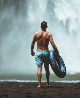 man by a waterfall
