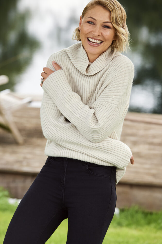 Emma Willis models her cosy cable knit jumper for Next