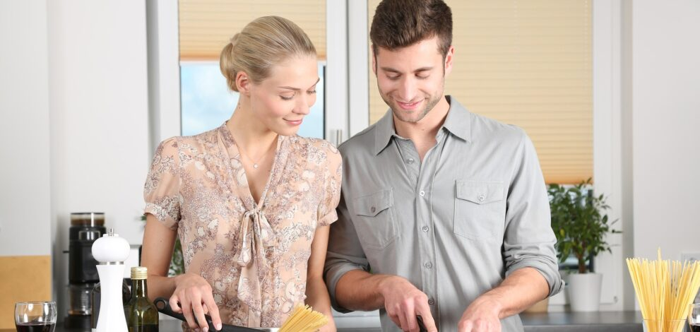 couple cooking in their perfect kitchen