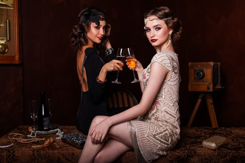 two women in 1920s style outfits